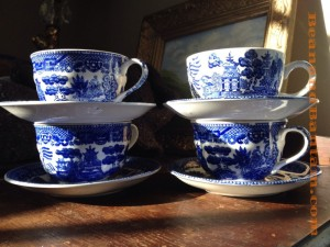 Winter sunlight, blue willow tea cups and saucers