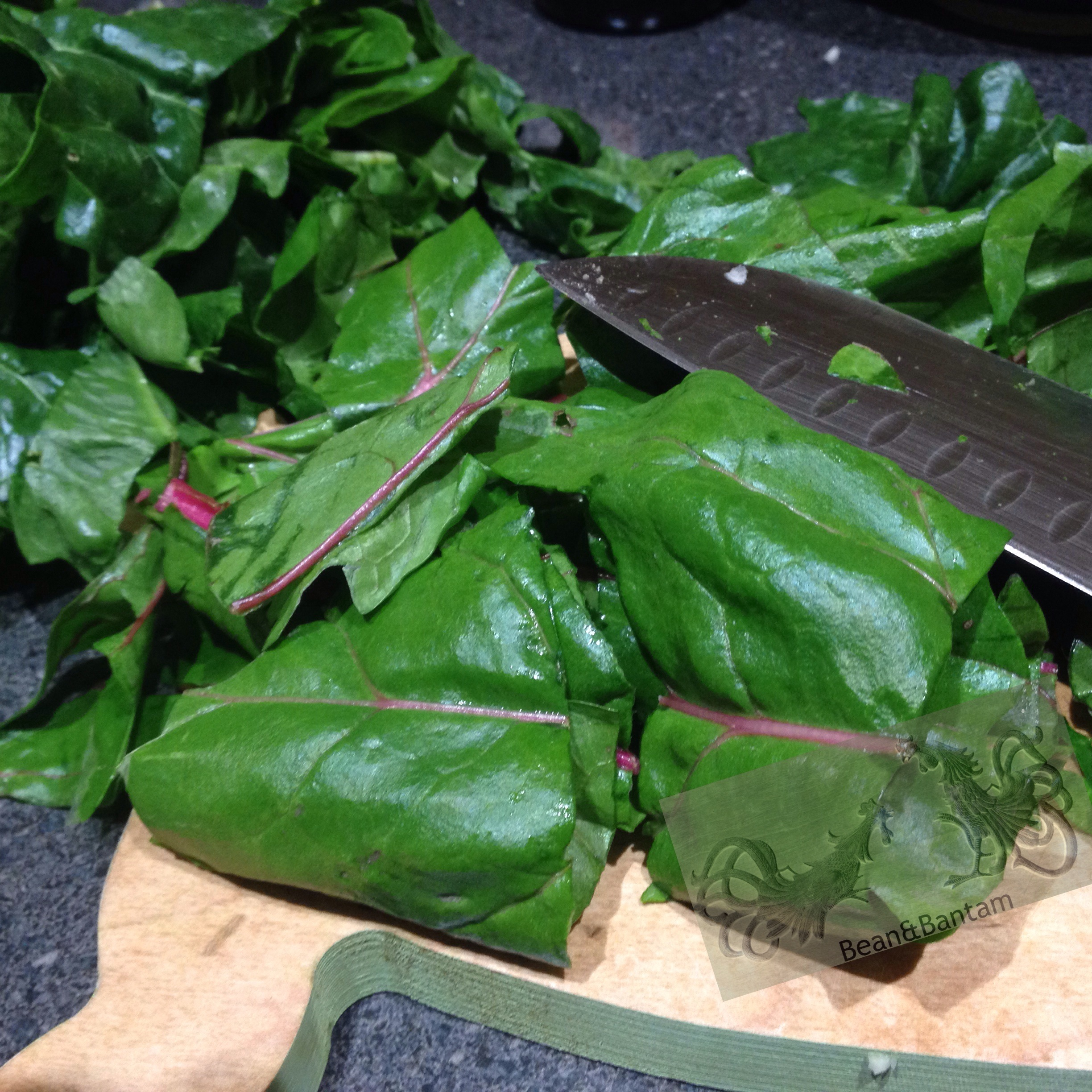 Chop leafy green chard head into sections