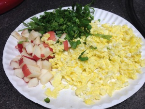 Chick treats: scrambled eggs, apple and parsley